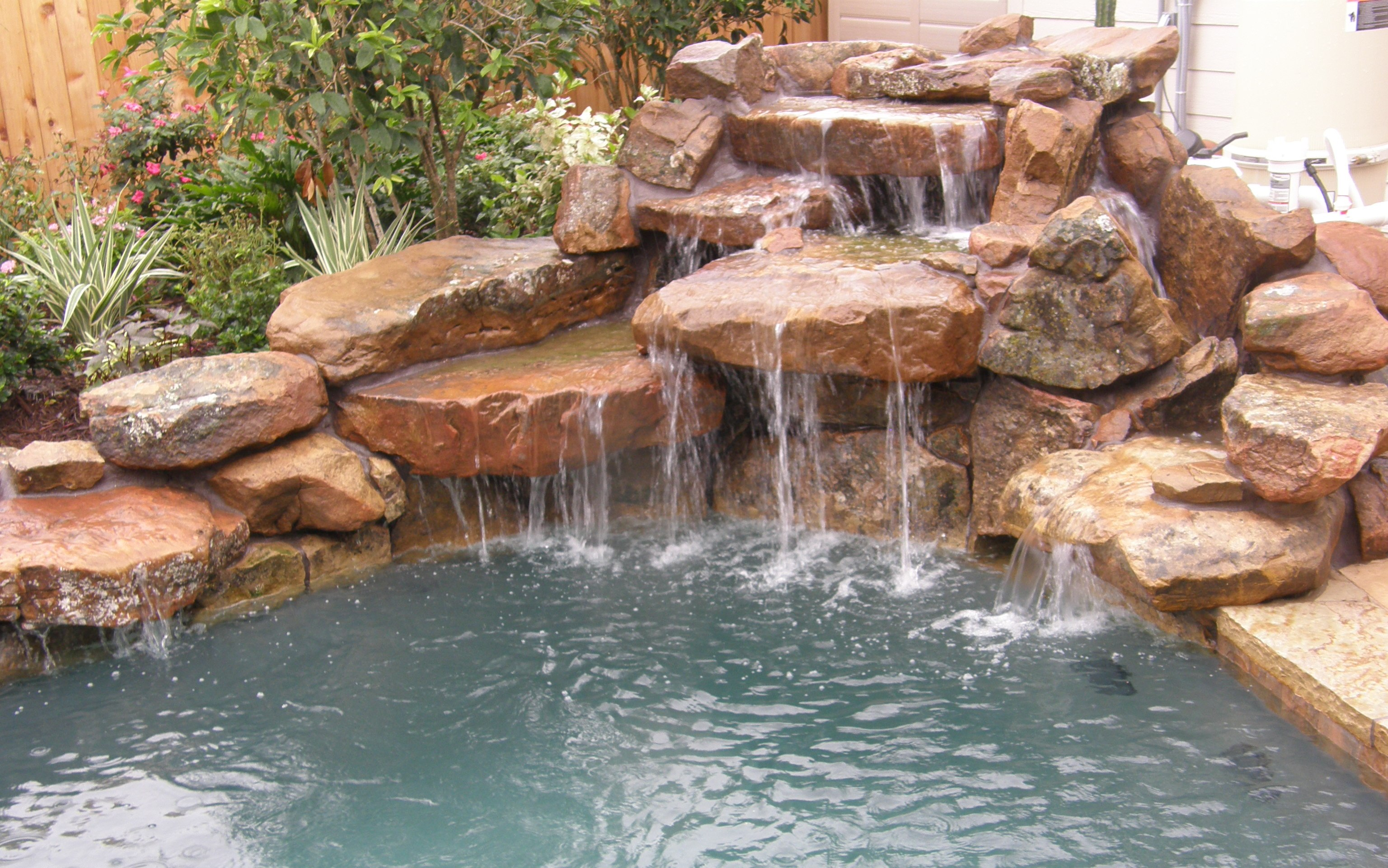 Lavish pools austin tx pool builder for Rock waterfall